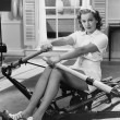Woman using rowing machine — Stock Photo #12290089