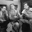 Three men smoking cigars — Stockfoto