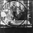 Couple through window in restaurant — Foto Stock