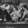 Couple having drink at crowded bar — Zdjęcie stockowe #12290209