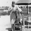 Woman with dog wearing hat and glasses — Stock fotografie