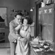 Couple in kitchen — Stockfoto