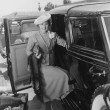 Woman with car and luggage - Stockfoto