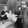 Couple and clerk in shop - 