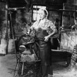 Female blacksmith — Stock Photo