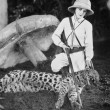 Female hunter with dead leopard - Stock Photo