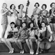 Group of young women playing instrument — Stock Photo #12291172