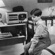 Boy listening to radio in bedroom - Foto de Stock