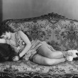 Woman asleep on couch — Stok fotoğraf