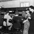 Telephone operators at switchboard — Stock Photo