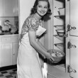 Stock Photo: Portrait of womin kitchen