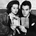 Shocked couple reading together — Stock Photo