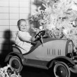Child with toy car under Christmas tree — Stock Photo #12291729