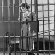 Stock Photo: Woman in jail cell