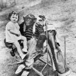 Monkey with golf clubs and toddler girl — Stock Photo #12292423