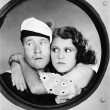 Woman hugging sailor at porthole — Stock Photo