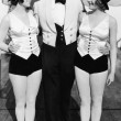 Portrait of man with two women wearing top hats — ストック写真