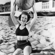 Stock Photo: Portrait of womwith ball at beach