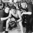Boxer in corner with trainers — Stock fotografie