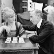Man with woman playing card game — Stock Photo