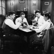Stock Photo: Four men playing cards