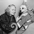 Woman with dog in Christmas outfit - Foto Stock