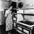 Woman with large stove - Foto Stock