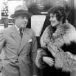 Woman in a fur coat having a conversation with a man — Stock Photo