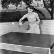 Young woman playing table tennis — Stock Photo