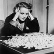 Young woman trying to solve a puzzle — Stock Photo