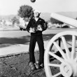 Man in sailors uniform trying to juggle cannon balls — Stock Photo #12294177