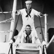 Stock Photo: Two sailors standing on gangway