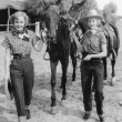 Two women with their horses — Stok fotoğraf