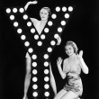 Two young women posing with the letter Y — Stok fotoğraf