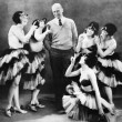 Five young women dancing around a man — 图库照片