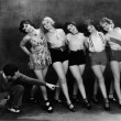 Dance instructor instructing five young women - Stock Photo