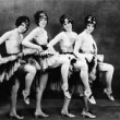 Portrait of four young women performing a dance - Foto de Stock  