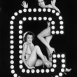 Two young women posing with the letter C — Stock Photo
