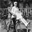 Couple sitting on a tandem bicycle — Stock Photo
