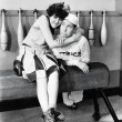 Young woman embracing a young man on a pommel horse — Stock Photo