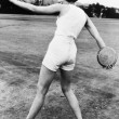 Rear view of a young woman throwing a discus — Stock Photo