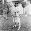 Woman playing croquet in the yard — Stock Photo