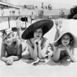Portrait of three young women lying on the beach - Lizenzfreies Foto