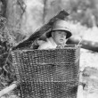 Man hiding himself in a basket — Stockfoto