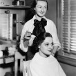 Young woman getting her hair done in a hair salon — Stock Photo #12295416