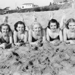 Portrait of five young women lying on the beach and smiling — Stock Photo #12296281
