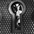 Stock Photo: Image of couple kissing viewed through keyhole