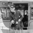 Conductor on a horse drawn streetcar holding the reins — Foto Stock