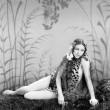 Woman in a Leopard skin sitting on the ground — ストック写真