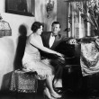 Man sitting with woman playing the piano — Foto Stock